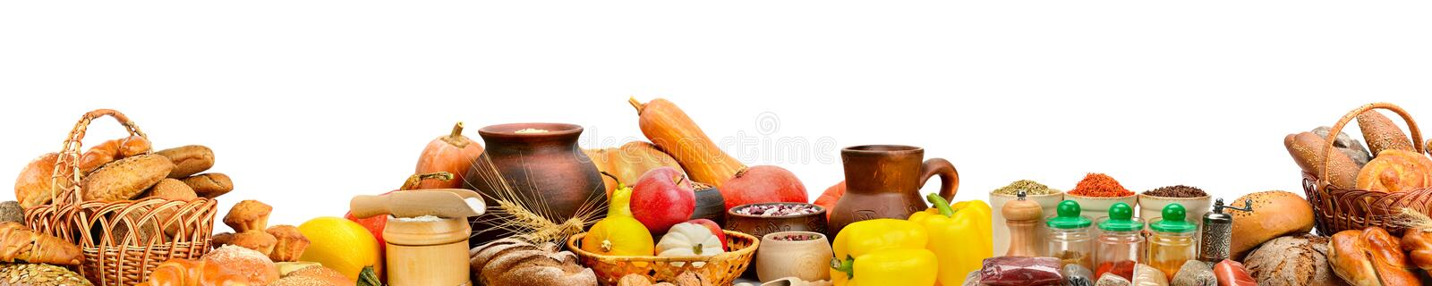 Wide photo with fresh fruits, vegetables, bread, dairy products, spices isolated on white background. royalty free stock images