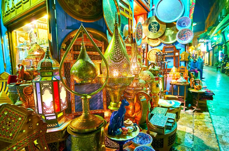 The wide range of Arabian lights, handmade metal lamps with scenic ornaments, stained-glass chandeliers and interesting souvenirs royalty free stock photo