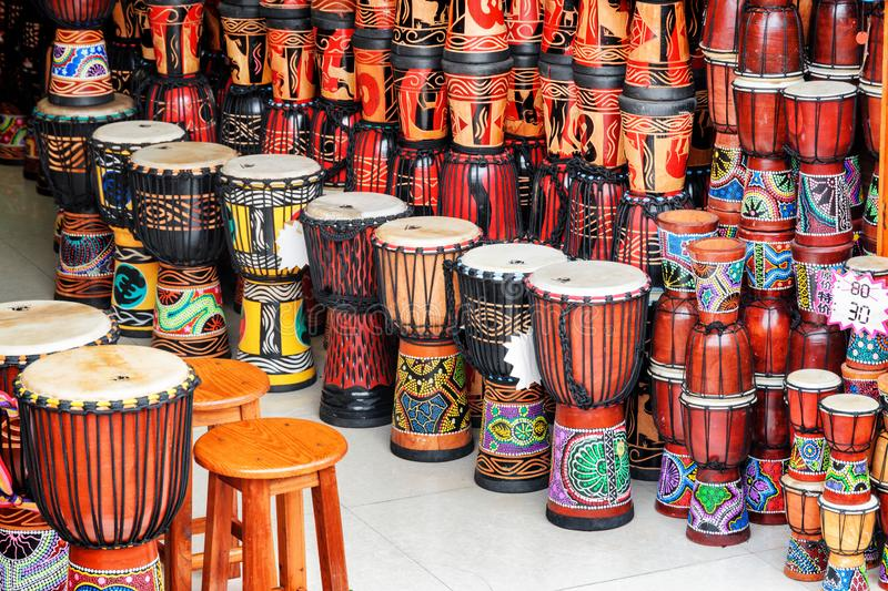 Wide range of colorful djembe drums at souvenir shop. Fenghuang, China - September 22, 2017: Wide range of colorful djembe drums at souvenir shop in Phoenix royalty free stock image