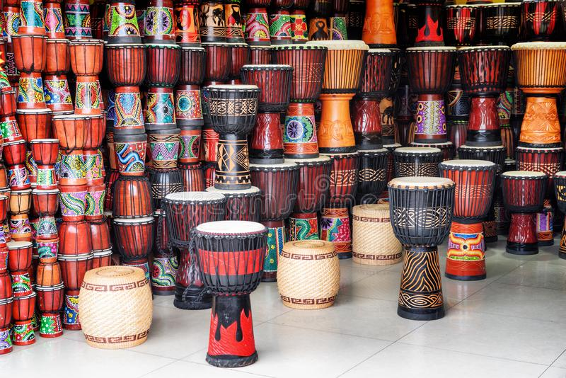 Wide range of colorful wooden djembe drums at souvenir shop. Fenghuang, China - September 22, 2017: Wide range of colorful wooden djembe drums at souvenir shop stock images