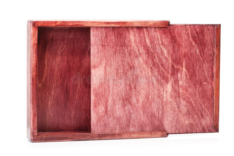 A wide raw wooden box for small items isolated on white background. Empty opened container for delivering. Business. A close-up picture of a wine-colored wooden royalty free stock photo