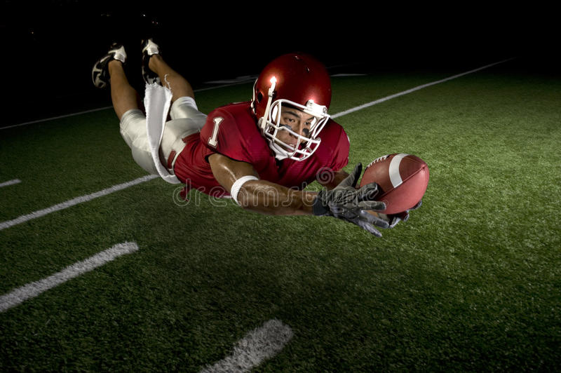 Wide Receiver Making a Diving Catch stock photo
