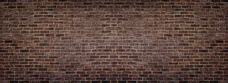 Wide red shabby brick wall texture. Masonry panorama. Dark rough brickwork panoramic background royalty free stock photography