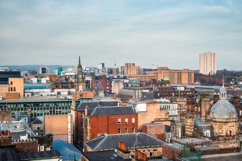 A wide rooftop view looking out over the buildings of Glasgow city centre. A wide rooftop view looking out over the buildings and architecture of Glasgow city royalty free stock images