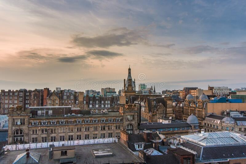 Rooftop view of Glasgow city centre at sunset, Scotland. A wide rooftop view looking out over the buildings and architecture of Glasgow city centre at sunset stock photography