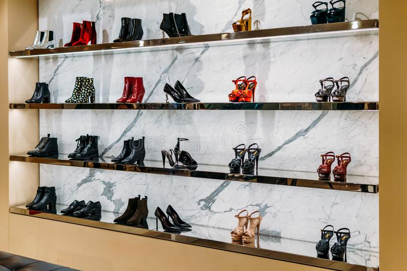 Wide Selection Of Women Shoes In Shopping Mall Store Inside. AMSTERDAM, NETHERLANDS - NOVEMBER 14, 2017: Wide Selection Of Women Shoes In Shopping Mall Store royalty free stock photos
