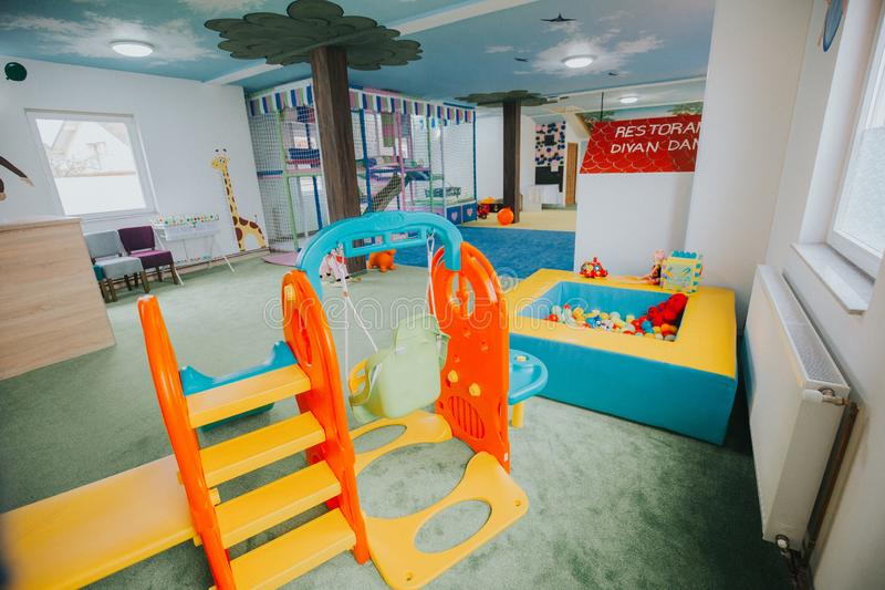 Wide shot of boys and girls playground area at a daycare center. A wide shot of boys and girls playground area at a daycare center royalty free stock image