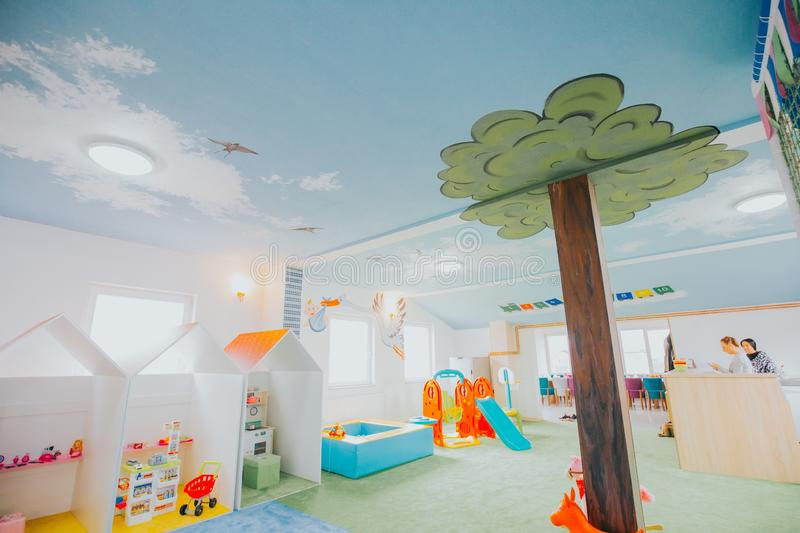 Wide shot of boys and girls playground area at a daycare center. A wide shot of boys and girls playground area at a daycare center stock photos