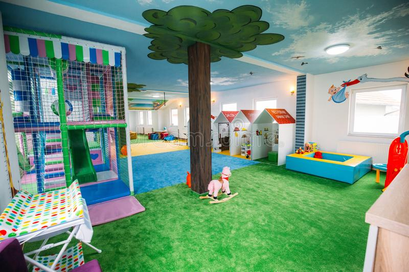 Wide shot of boys and girls playground area at a daycare center. A wide shot of boys and girls playground area at a daycare center royalty free stock photography