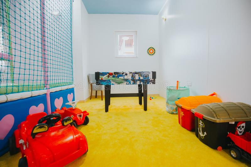 Wide shot of boys and girls playground area at a daycare center. A wide shot of boys and girls playground area at a daycare center royalty free stock images