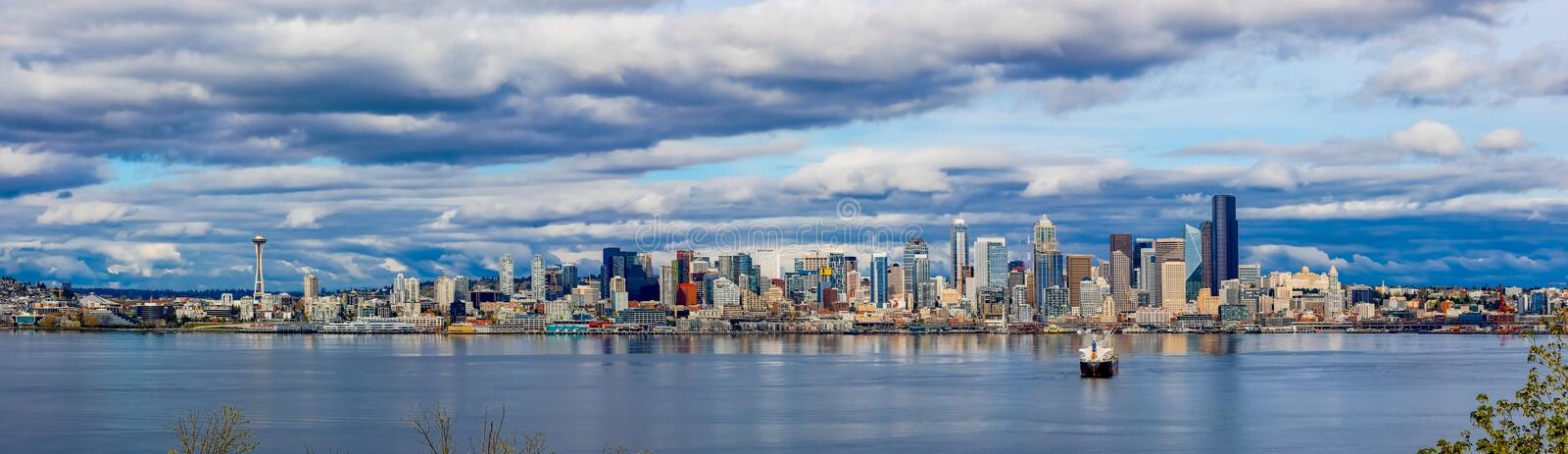 Wide shot of the coastline in the city of Seattle, USA under the beautiful cloudy sky. A wide shot of the coastline in the city of Seattle, USA under the stock photo