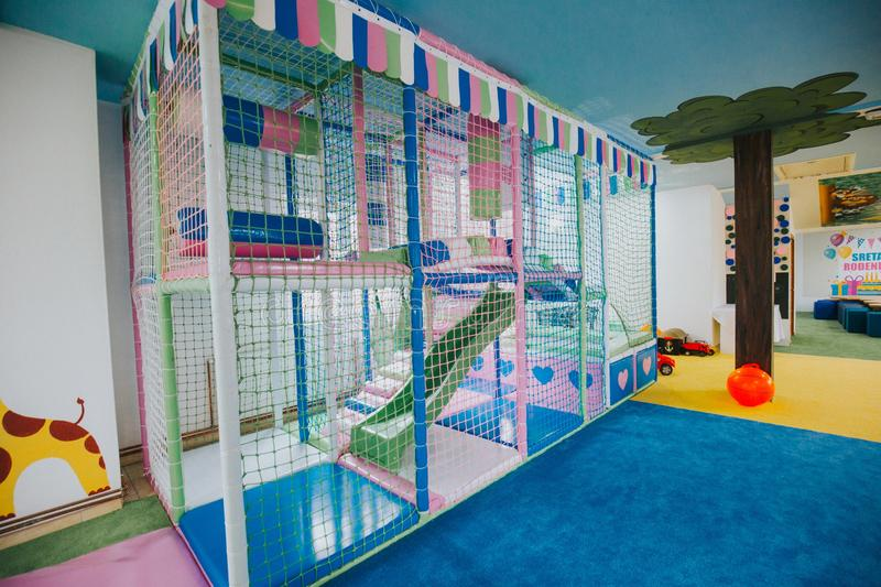 Wide shot of a colorful daycare center playground. A wide shot of a colorful daycare center playground royalty free stock images