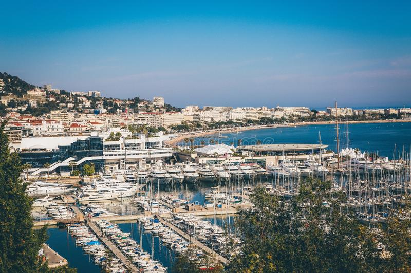 Wide shot of docks with yachts and motorboats surrounded by buildings in Monte Carlo, Monaco royalty free stock image