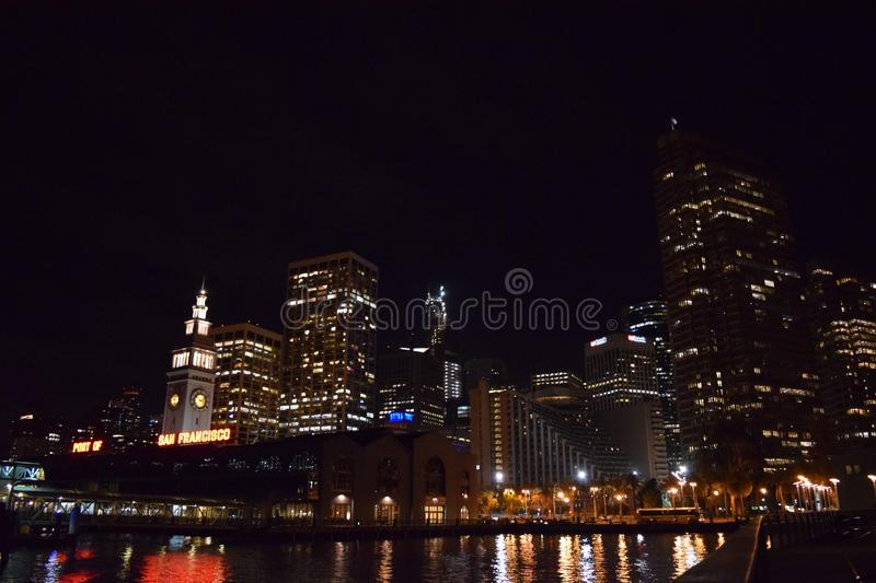 Wide shot of high rise buildings at the port during the night in San Francisco, California. A wide shot of high rise buildings at the port during the night in stock photography