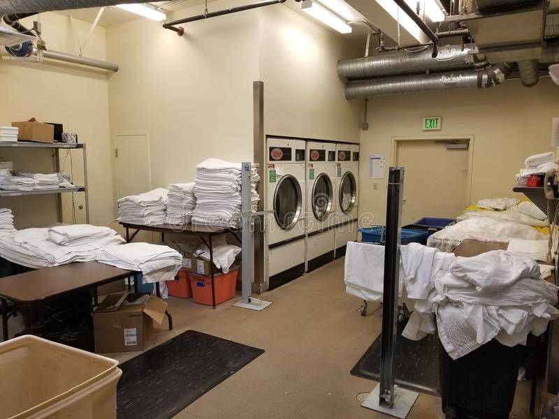 Wide shot of hotel laundry room stock photography
