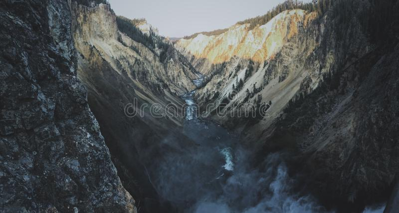 Wide shot a lake flowing in the middle of the mountains at grand canyon of the Yellowstone royalty free stock image