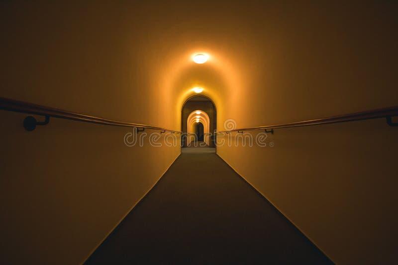 Wide Shot of a long dark tunnel, creepy scene. Wide Shot of a long dark tunnel, creepy underground scene royalty free stock image