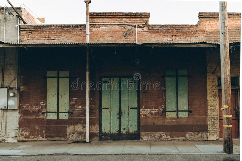 Wide shot of an old abandoned brick building in the suburbs royalty free stock photography