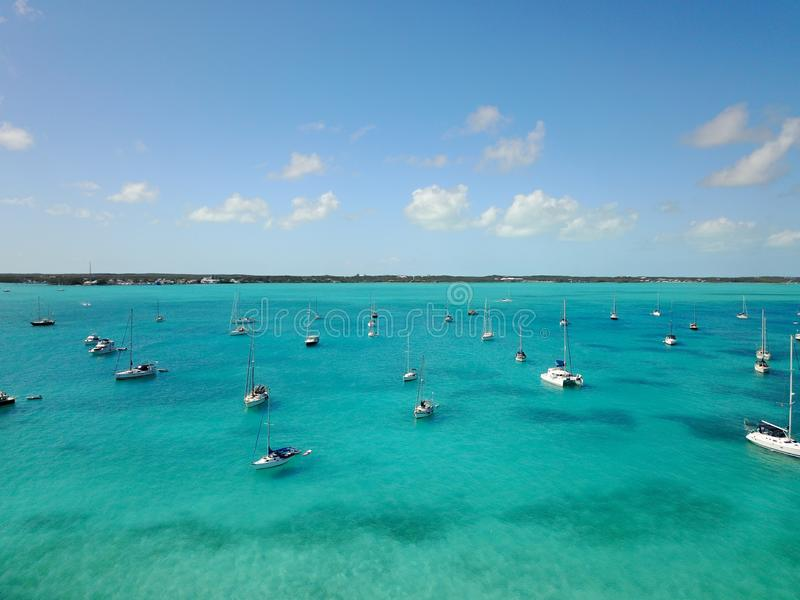 Wide shot of sailboats on the body of the water under a clear sky in Exuma. A wide shot of sailboats on the body of the water under a clear sky in Exuma stock photography