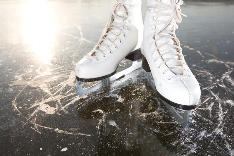 Wide skates on ice with sun royalty free stock photo