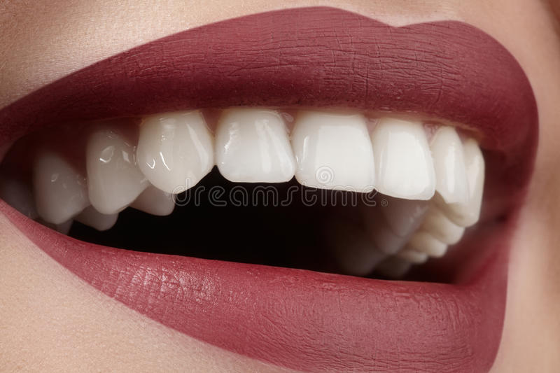 Wide smile of young beautiful woman, perfect healthy white teeth. Dental whitening, ortodont, care tooth and wellness. Wide smile of young beautiful woman with stock photography