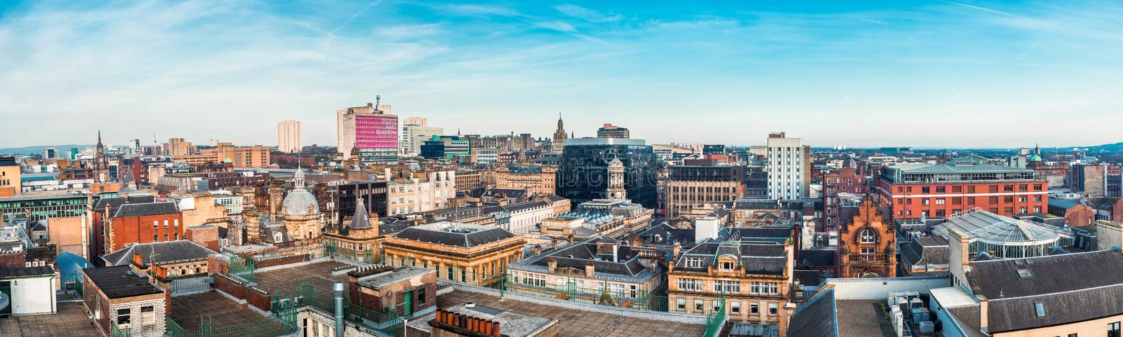 A wide stitched panoramic looking out over buildings in Glasgow city centre, Scotland royalty free stock images