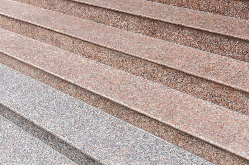 Wide stone staircase of gray and pink marble. Side view stock images