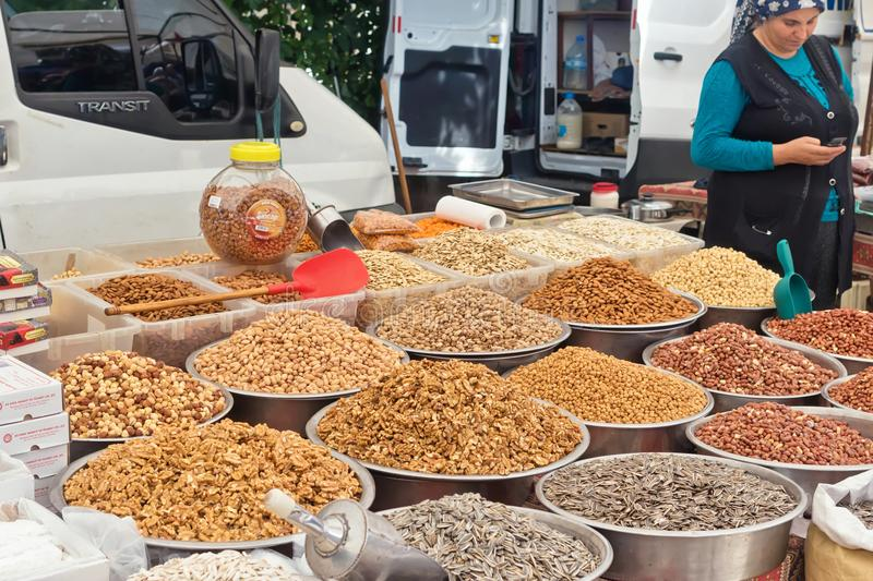 Wide variety of spices, nuts and dried fruits on the shelves of local street market traders royalty free stock photos