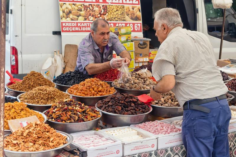 Wide variety of spices, nuts and dried fruits on the shelves of local street market traders. ANTALYA, TURKEY - MAY 17: A wide variety of spices, nuts and dried royalty free stock photography