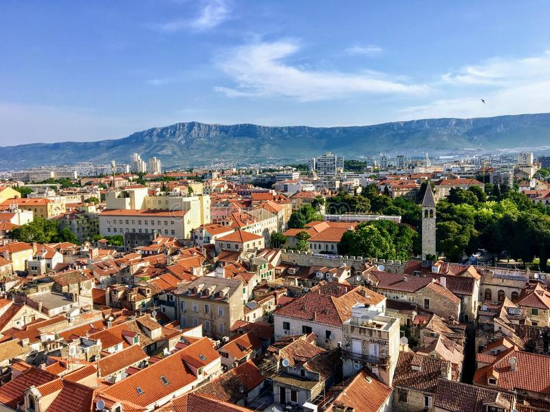 A wide view of the beautiful city of Split, Croatia from high above atop the clock tower in the old town. In the background are the mosor mountain ranges royalty free stock image