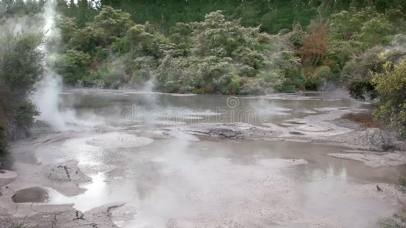 Wide view of a boiling mud pool stock photo