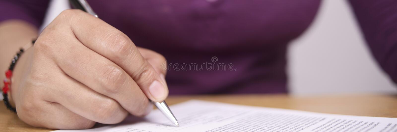 Wide View of Businesswoman Signing Contract royalty free stock image
