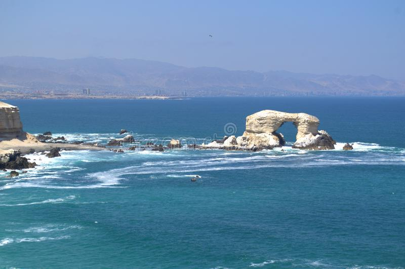 Natural formation `La Portada` The Gate in Antofagasta, Chile. Wide view of the cliffs and natural rock formation `La Portada` The Gate in Antofagasta, Chile stock image