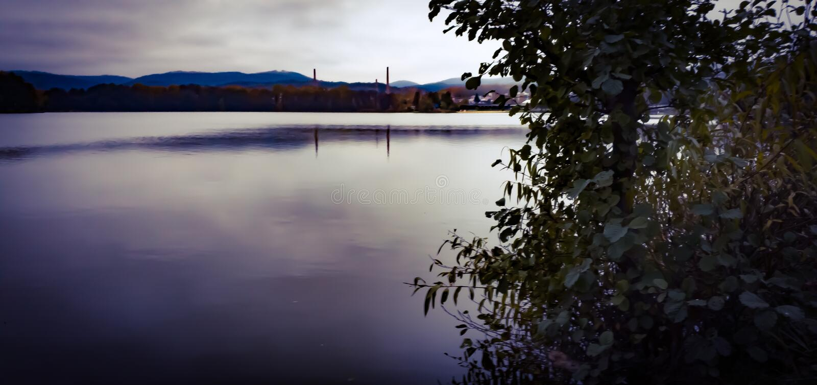 Wide view on a dark landscape. stock photos