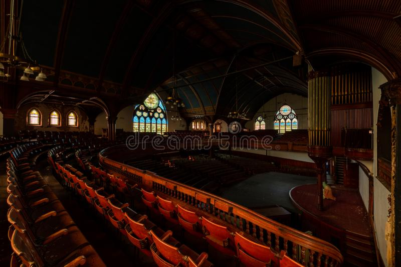 Derelict Sanctuary with Stained Glass Windows & Organ - Abandoned Church - Lowell, Massachusetts. A wide view of a derelict sanctuary with stained glass windows royalty free stock photos