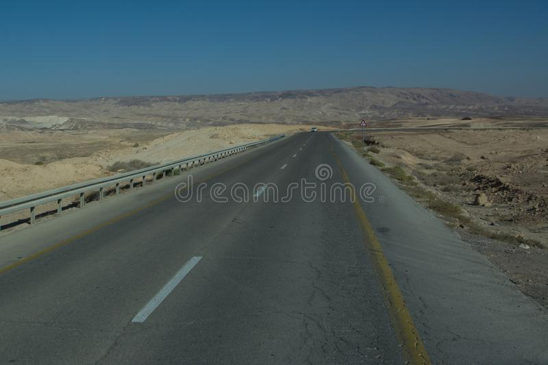 Wide view of desert road through the Isreal southwest. royalty free stock photography
