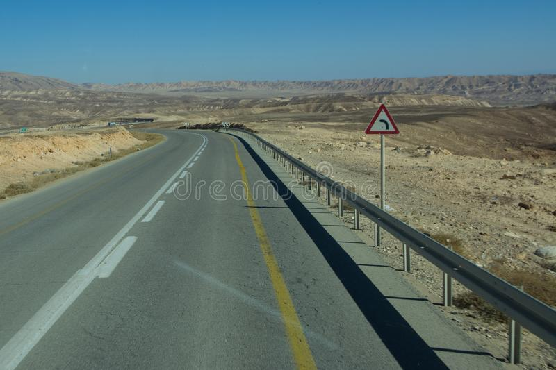 Wide view of desert road through the Isreal southwest. View of desert road through the Isreal southwest stock photo