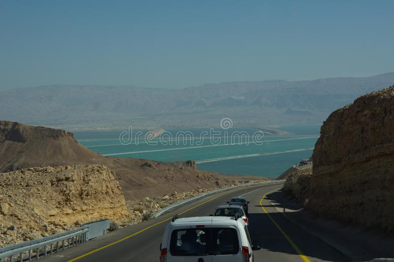 Wide view of desert road through the Isreal southwest. View of desert road through the Isreal southwest royalty free stock photos