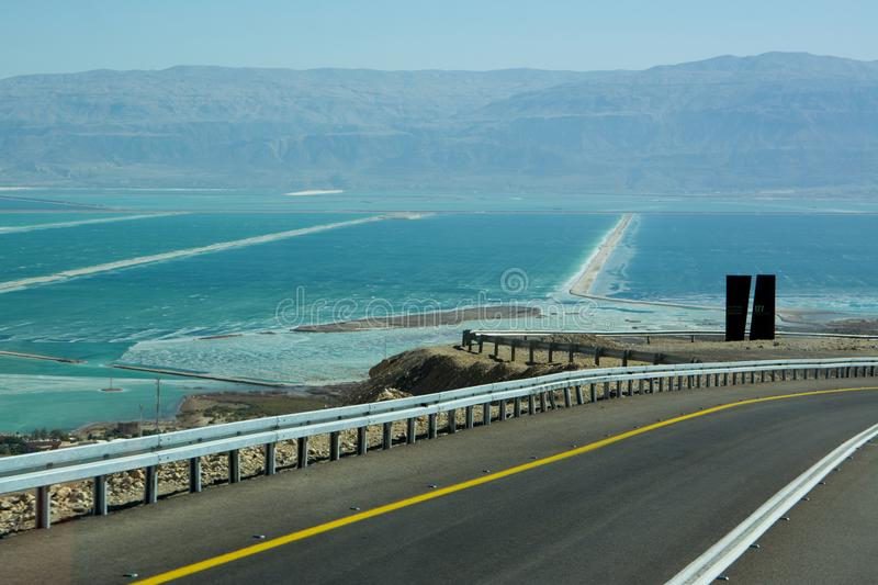 Wide view of desert road through the Isreal southwest. View of desert road through the Isreal southwest stock image