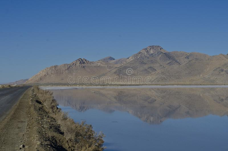 A wide view of f the country road along the salt ponds royalty free stock photos