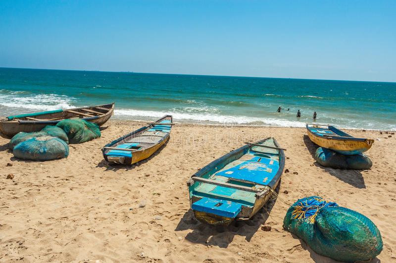 Wide view of group of fishing boats parked in seashore with people in the background, Visakhapatnam, Andhra Pradesh, March 05 2017. Wide view of group of fishing stock photo
