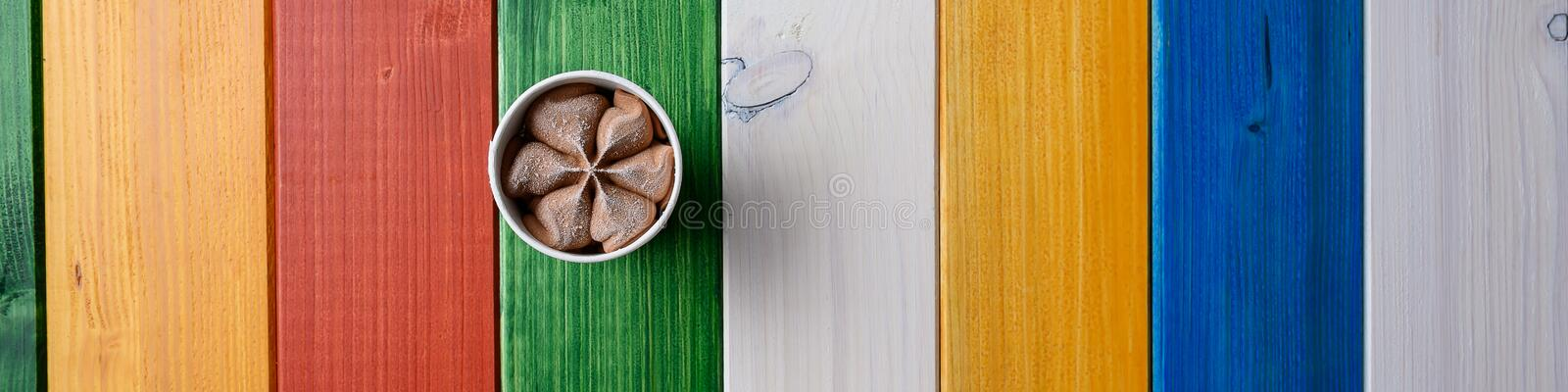 Wide view image of chocolate ice cream in paper cup royalty free stock image