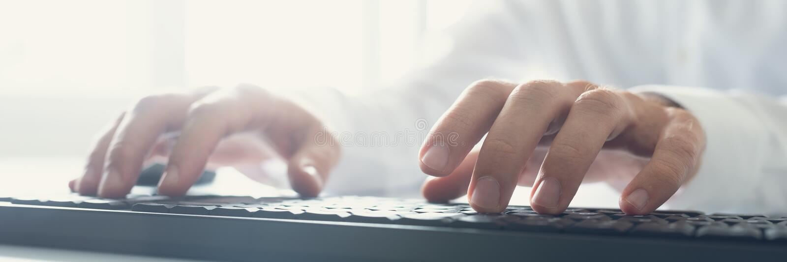 Wide view image of computer programmer typing royalty free stock photography
