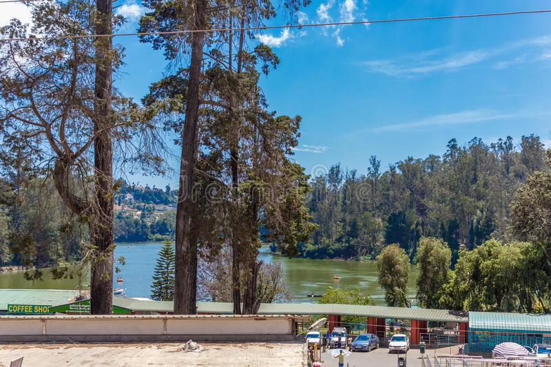 Wide view of lake with people, beautiful tress in the background, Ooty, India, 19 Aug 2016 royalty free stock image