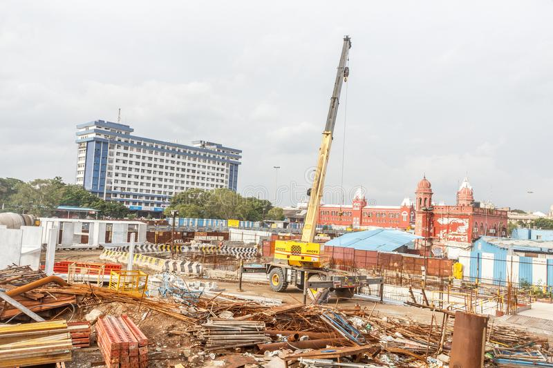 Wide view of metro train work area under construction seen with huge hydraulic machines. And other different contruction equipment and hardware at Central stock image
