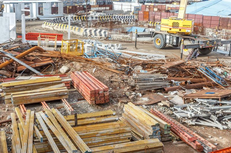Wide view of metro train work area under construction seen with huge hydraulic machines. And other different contruction equipment and hardware at Central stock images