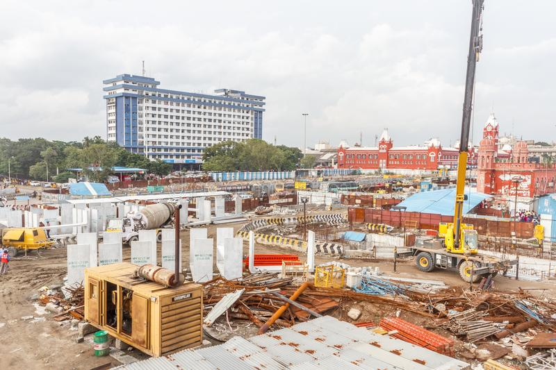 Wide view of metro train work area under construction seen with huge hydraulic machines. And other different contruction equipment and hardware at Central royalty free stock photo