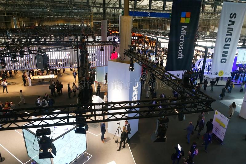 Wide view over company booths at the Mobile World Congress 2019 in Barcelona. Wide view over company booths at hall 3 inside the Mobile World Congress 2019 in stock photos