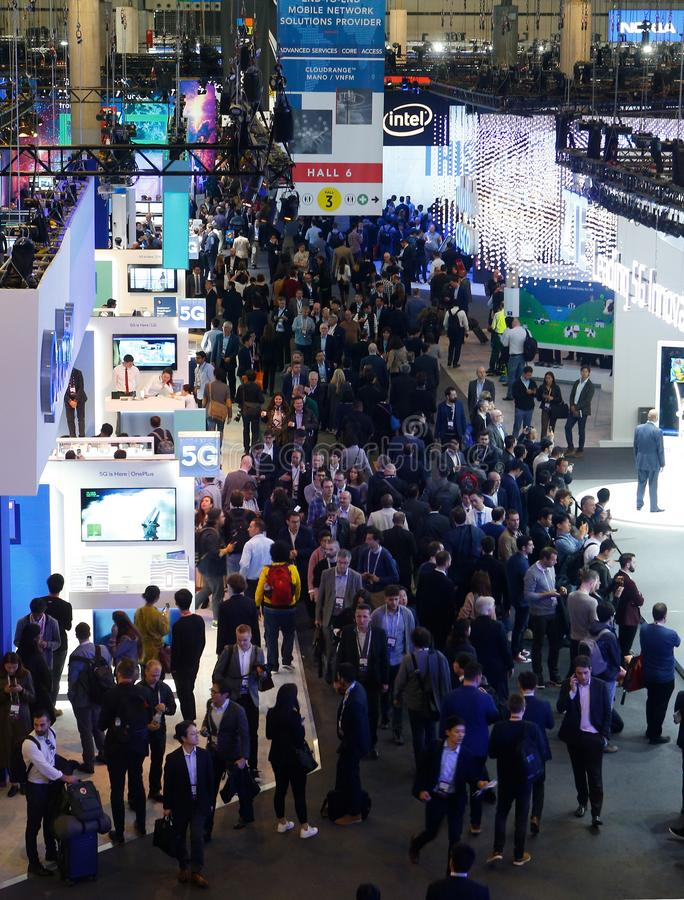 Wide view over company booths at the Mobile World Congress 2019 in Barcelona vertical. Wide view over company booths at hall 3 inside the Mobile World Congress stock images