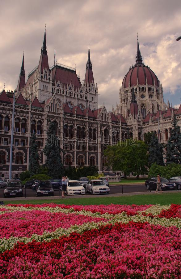 Wide view of Parliament building in Budapest, Hungary and garden with flowers. BUDAPEST, HUNGARY - SEPTEMBER 14 2011: wide view of Parliament building in stock images
